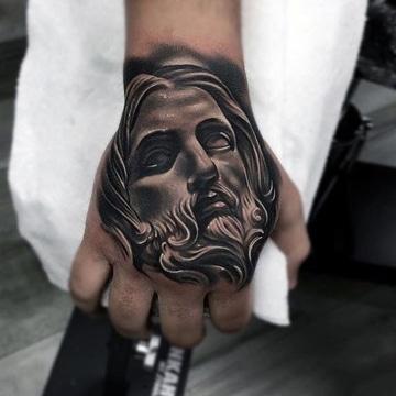 tatuajes de cristo en la mano crucificado