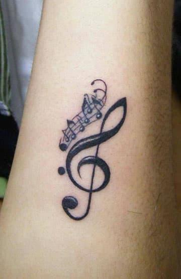tatuajes de letras musicales notas