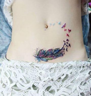 tatuajes de colores para mujeres vientre