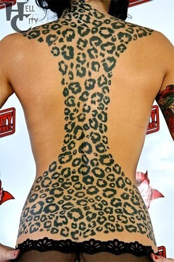 tatuajes de manchas de leopardo espalda