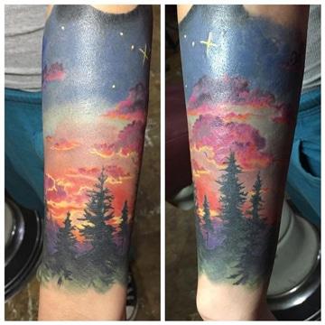 tatuajes de paisajes en el brazo a color