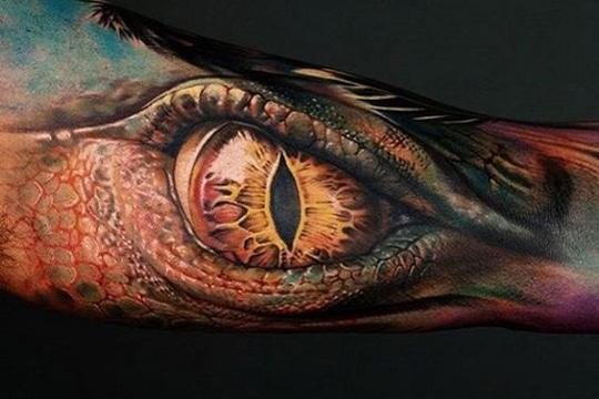 tatuajes chidos en el brazo ojo dragon