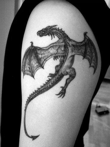 tatuajes de dragones en el brazo sencillos