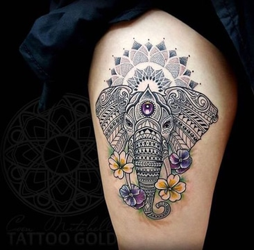 tatuajes de ganesha en mujeres con color