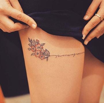 tatuajes femeninos en la pierna discretos