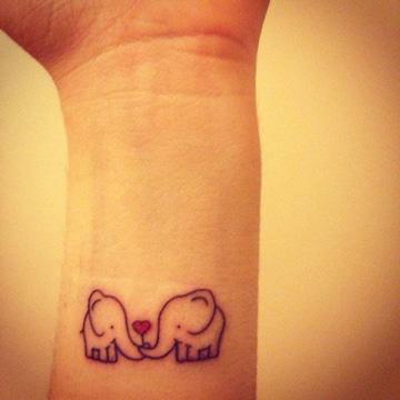 imagenes de tatuajes de elefantes de amor