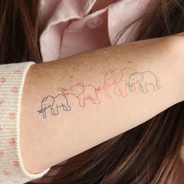 imagenes de tatuajes de elefantes en brazo