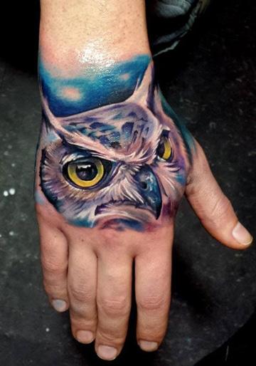 tatuajes de buhos en la mano ideas