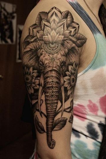 tatuajes de elefantes para hombres en brazo