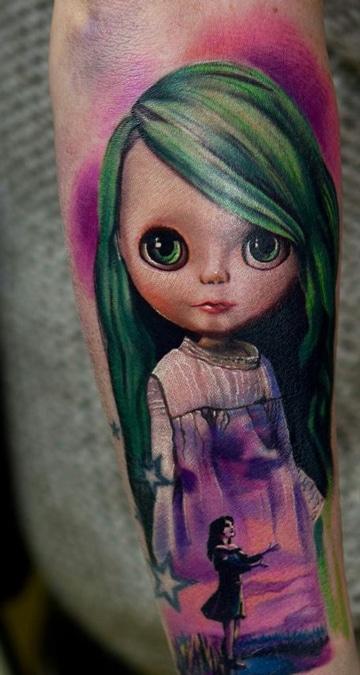 tatuajes de muñecas de trapo en brazo