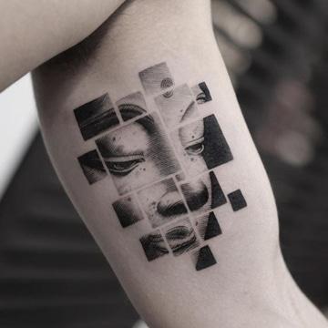 tatuajes de budas en el brazo imagen cara