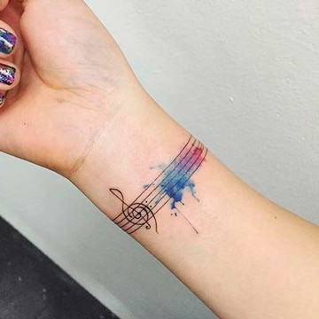 tatuajes de musica para mujeres muneca