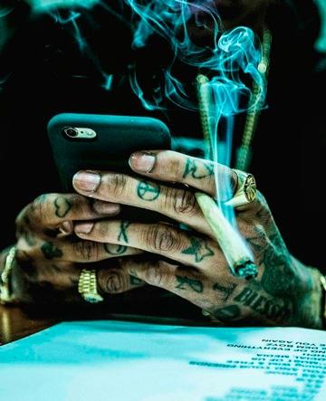 tatuajes de wiz khalifa en mano