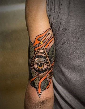 tatuajes de ojos en el brazo para hombre