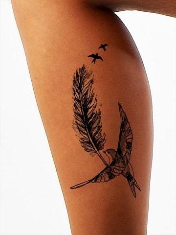 tatuajes que simbolizan libertad en la pierna