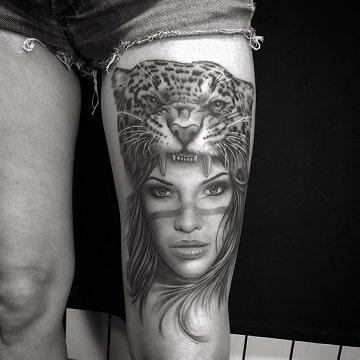 tatuajes de caras de mujeres en la pierna