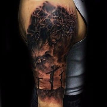 tatuajes de jesus de nazaret en el brazo