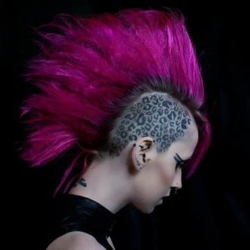 tatuajes de manchas de leopardo en la cabeza