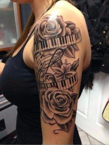tatuajes de signos de musica para mujeres