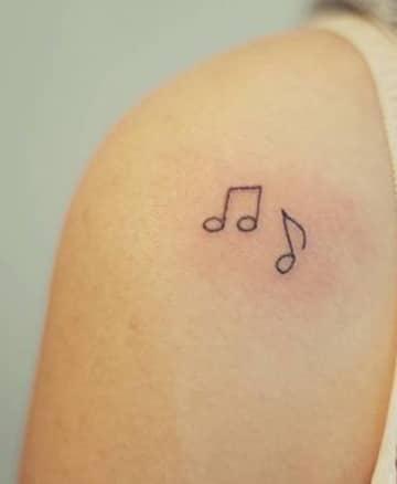 tatuajes de signos musicales pequeños
