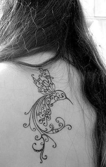 tatuajes de aves en la espalda mujer