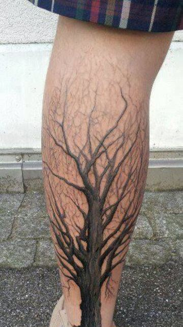 tatuajes de arboles secos en pierna de hombres