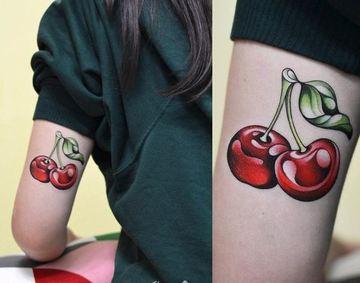 tatuajes de cerezas para mujeres en antebrazo