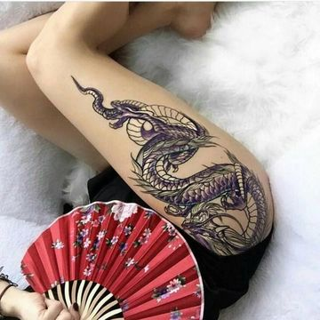 tatuajes de dragones para mujeres en la pierna