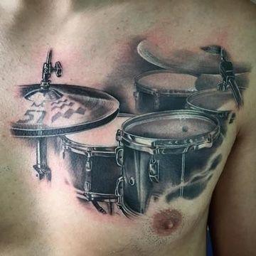 tatuajes bacanos para hombres en pectorales