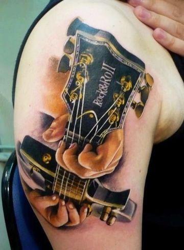tatuajes de guitarras para mujer grandes