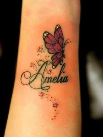 tatuajes de nombres con dibujos en el brazo