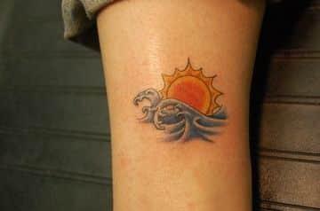tatuajes de puestas de sol en la playa