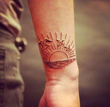 tatuajes de puestas de sol para hombres