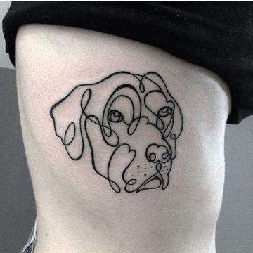 imagenes de tatuajes de perros dibujados en el costado