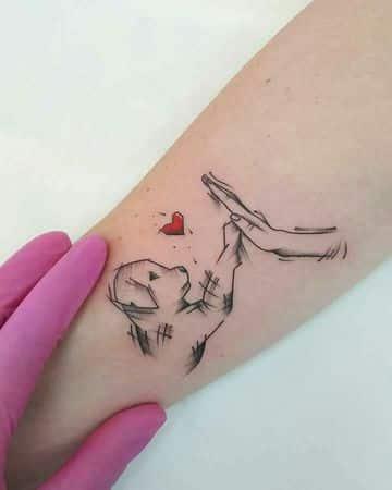 tatuajes de perros labradores en el brazo