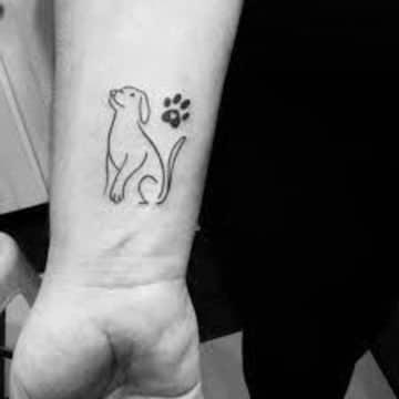 tatuajes de perros labradores en la muñeca