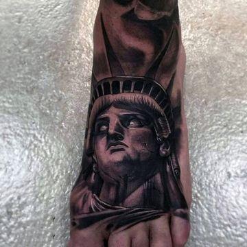 tatuajes en el pie para hombres de america