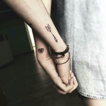 tatuajes simbolicos para parejas en los brazos