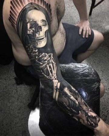 diseños de de tatuajes de la muerte en el brazo
