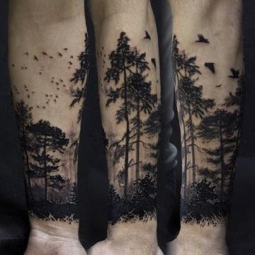 tatuajes de bosques para hombres en el antebrazo
