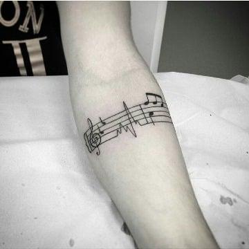 imagenes de tatuajes de musica para hombre