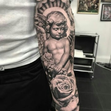 diseños de angeles para tatuar en el brazo