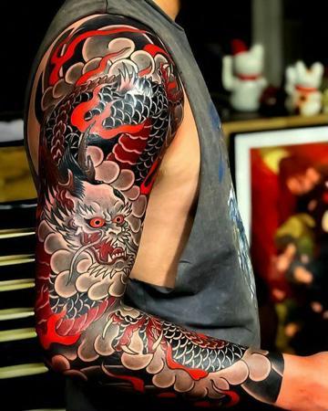 diseño de tattoo brazo completo japones