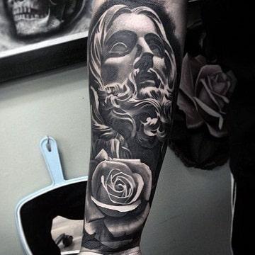 tatuajes de cristo en el brazo completo