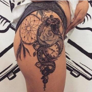 imaganes de tatuajes de serpientes en la pierna