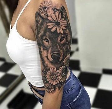 tatuajes de lobos en el brazo mujer