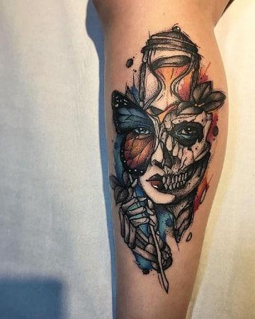 tatuajes de catrinas a colores en la pierna