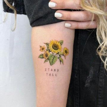 tatuajes de girasoles en el brazo con letras