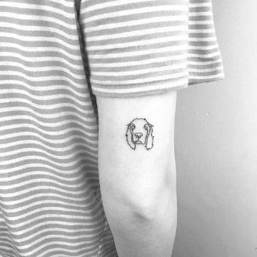 tatuajes de perros cocker en el brazo