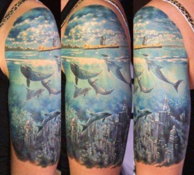 tatuajes de delfines en 3d brazo